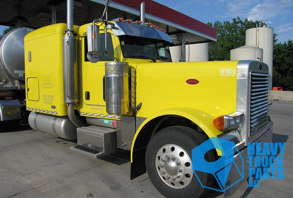 blue itrack logo watermarked over yellow semi truck